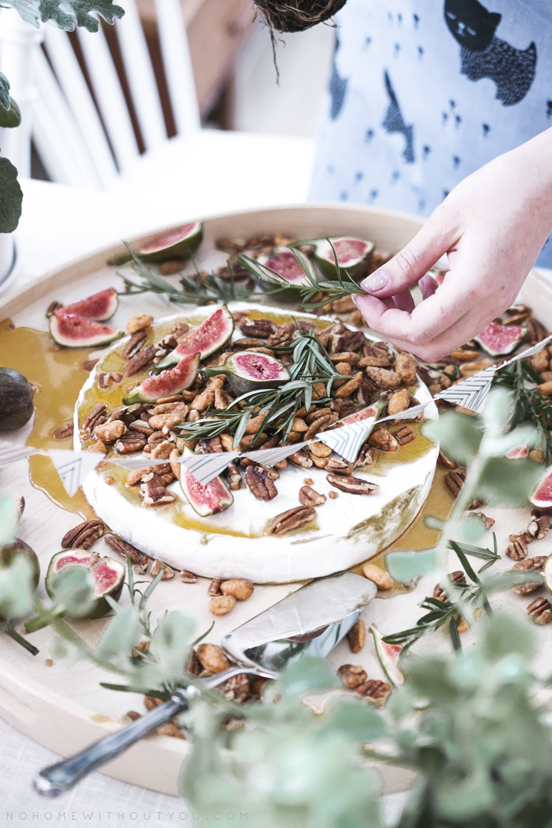 white cheese with fig, rosemary nuts and maple suryp