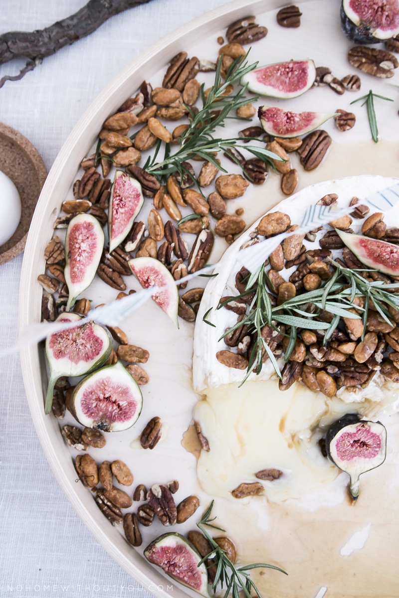 white cheese with maple suryp and nuts